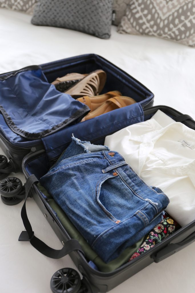 Travel Capsule Wardrobe In A Carry On Suitcase