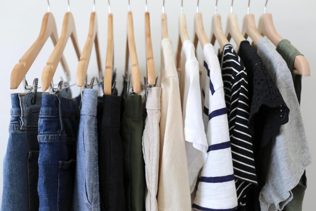 Travel Capsule Wardrobe On a Clothes Rack Closeup