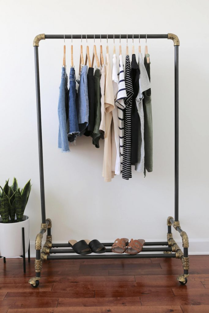 Travel Capsule Wardrobe On a Clothes Rack Full