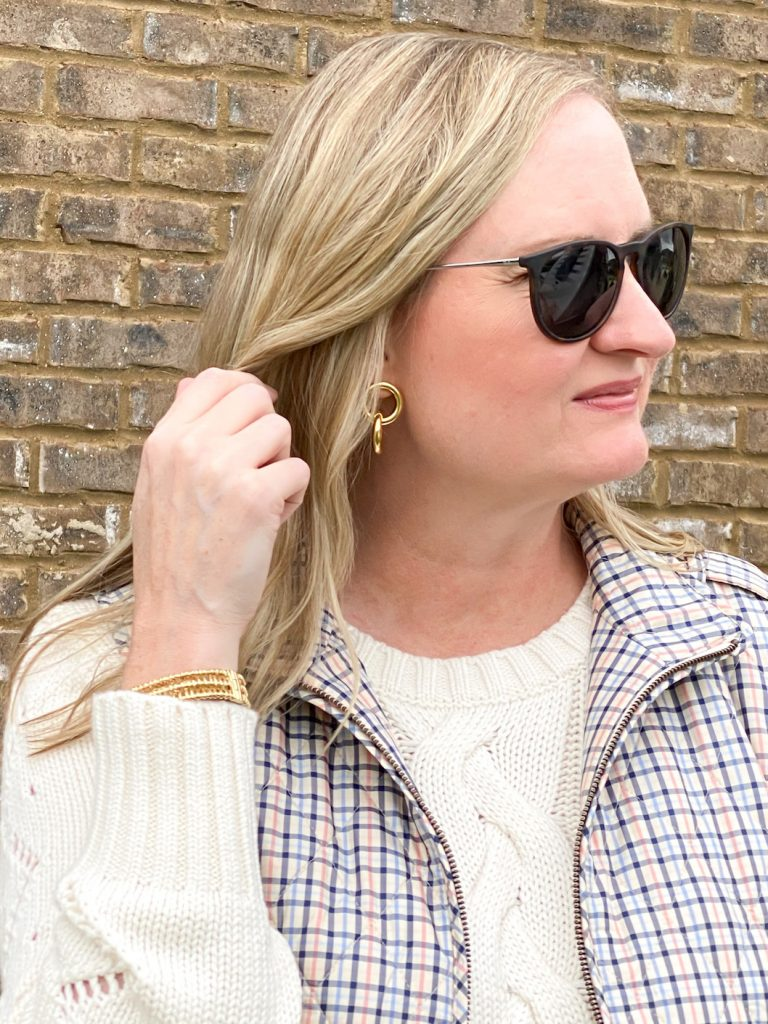 Classy Yet Trendy Wearing Talbots Cableknit Sweater Diamond Quilted Vest Loafers Gold Bangle Earrings